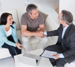 couple talking with financial advisor on a couch